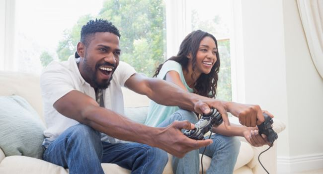 adults playing video games